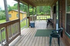 Relax anytime on our cabin's spacious porch